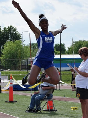 Brianna Richard of Winton Woods finishes her last attempt in the long jump at the district meet last season.