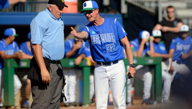 West Florida's head coach Mike Jeffcoat has words with the umpire Sunday during their home game against Mississippi College at the UWF Softball Complex.