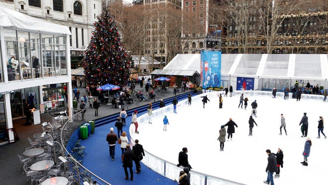 People ice skate at the Bryant Park Winter Village rink in Manhattan.