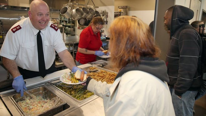 Bremerton Salvation Army Maj. Scott Ramsey serves food Tuesday on the lunch line.