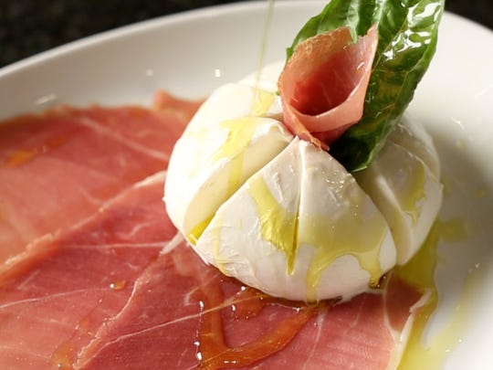 Homemade mozzarella with basil and prosciutto, drizzled with olive oil at Millie's Old World Meatballs and Pizza in Morristown.