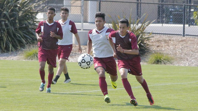 Hartnell's soccer team works on passing during a practice last week. The Panthers enter this season as defending conference champions.