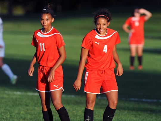Left, Amia and right, Tyra wait for the ball against