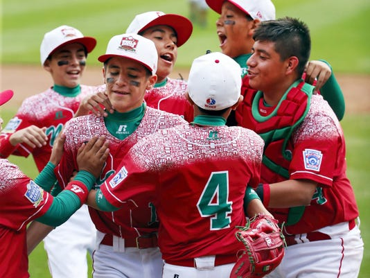 Mexico's Gerardo Lujano, second from left, celebrates with teammates after getting the final out of an International elimination baseball game against Venezuela at the Little League World Series tournament in South Williamsport, Pa. on Thursday. Mexico won 11-0.