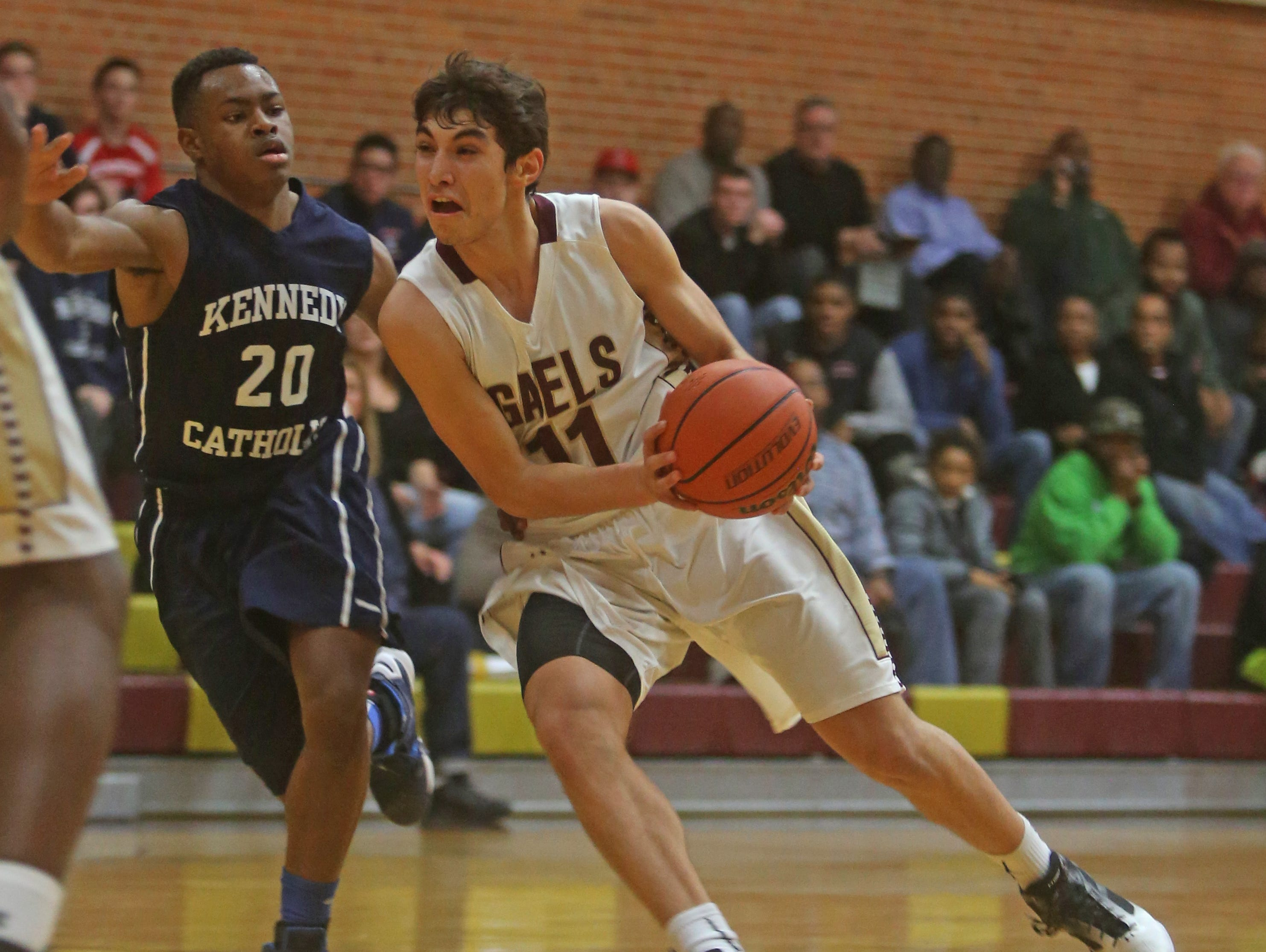 Iona Prep's Ty Jerome drives past Kennedy Catholic's Alex Benson during a varsity basketball game against Kennedy Catholic at Iona Prep in New Rochelle Dec. 9, 2015. Iona Prep defeated Kennedy 75-49. Jerome finished with a game high 28 points.
