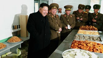 North Korean leader Kim Jong-un enjoys his Dec. 1 visit to an artillery unit at an undisclosed location.