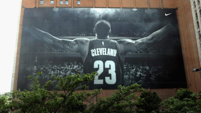 A general view of the Nike 'Welcome Home LeBron Banner' on the exterior of the Sherwin-Williams Co. Global Headquarters near Quicken Loans Arena prior to Game 4 of the 2016 NBA Finals between the Cleveland Cavaliers and the Golden State Warriors in Cleveland, Ohio.
