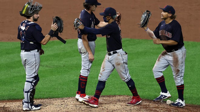 Cleveland Indians pitcher Cal Quantrill is congratulated by teammates after the final out in a 10-1 win against the Kansas City Royals at Kauffman Stadium in Kansas City, Missouri, on Tuesday, Sept. 1, 2020.