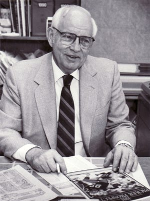 Lee Remmel, the Green Bay Packers' director of public relations, sits at his desk in the team's old administration building at Lambeau Field before the 1991 season.