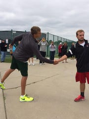 Iowa City West's David DiLeo, left, and Linn-Mar's Trevor McCann, both seniors, meet before squaring off in the championship.