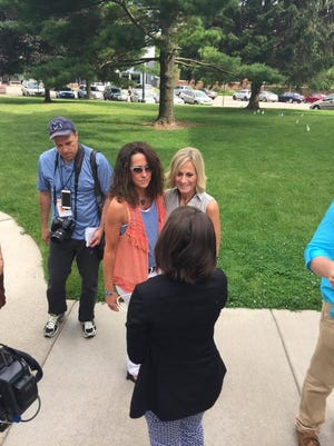 The first same-sex couple to marry in Ingham County after the Supreme Court ruling.