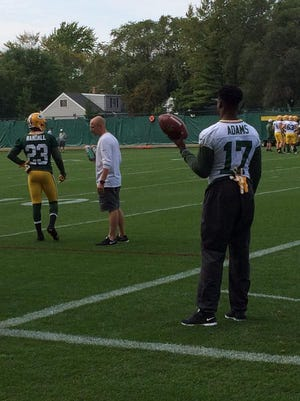Green Bay Packers receiver Davante Adams watches practice Thursday at Clarke Hinkle Field.