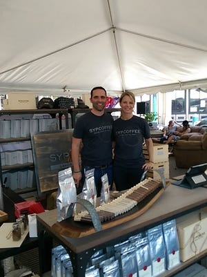 Craig and Melissa Margolius work a booth for SYPCOFFEE during the 2016 Brewfest in Franklin. They will also have a booth at the upcoming Made South event at The Factory June 30-July 1.