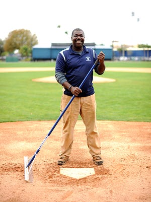 Living in Lakeland for 30 years made grounds crew member Carther McCall a Tigers fan.