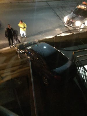 A photo from Iowa City resident Bryan Tanner shows the gray Pontiac that Brian David Bordwell allegedly drove over a pedestrian bridge in Iowa City. The picture shows the car parked at the exit of the bridge's walkway early Friday morning.