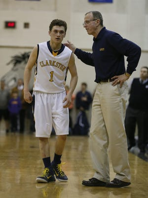 Clarkston's Foster Loyer listens to instructions from head coach Dan Fife, March 18, 2015 in Troy, Mich.