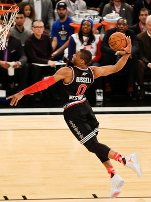 The West's Russell Westbrook, of the Oklahoma City Thunder, dunks the ball during the first half of the NBA All-Star Game on Sunday in New York.