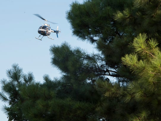 The ALEA helicopter searches the Tallapoosa River in