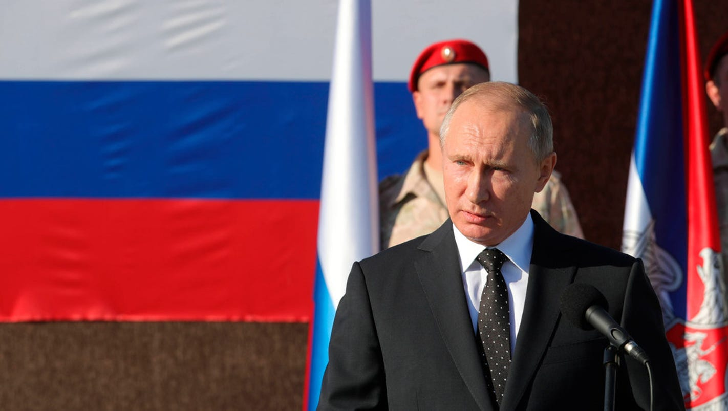Russia's Putin orders 'significant' withdrawal of troops from Syria