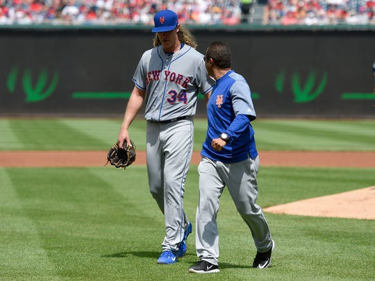 Mets pitcher Noah Syndergaard leaving with an injury