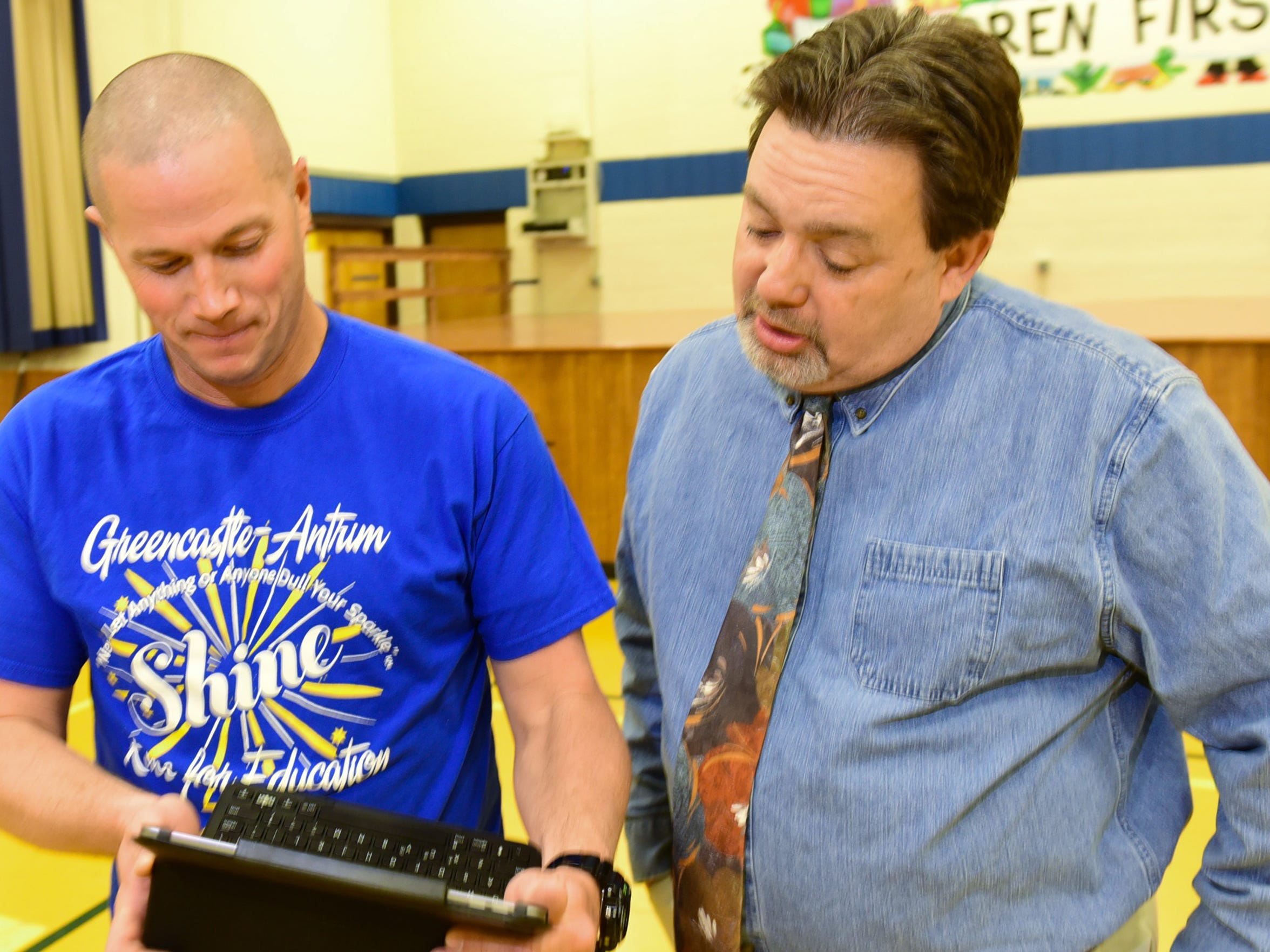 Greg Hoover, right, Greencastle-Antrim School District superintendent, chats with teacher Donnie Cordell, Tuesday, April 12, 2016, is retiring in June.
