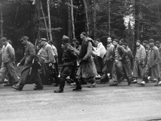 Jack Marcus (next to the rifle carried by a German guard) marches along the Noerdlichen Muenchner street in Gruenwald on a death march from Dachau. Marcus survived the Holocaust and died Tuesday in Milwaukee.