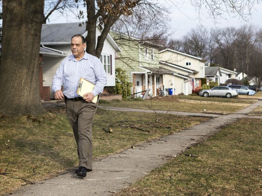 Republican senate candidate John Marino canvasses a neighborhood in Newark on Wednesday afternoon.