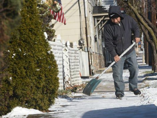STOCK-Snow shoveling