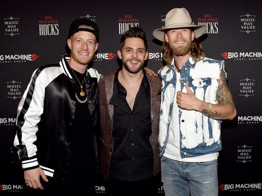 Thomas Rhett, center, says touring with Florida Georgia Line — Tyler Hubbard, left, and Brian Kelley — taught him how to throw a party on stage.