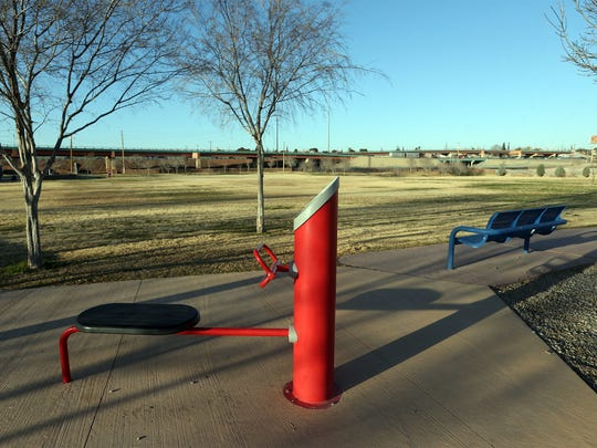 Benches and workout equipment at a city park along