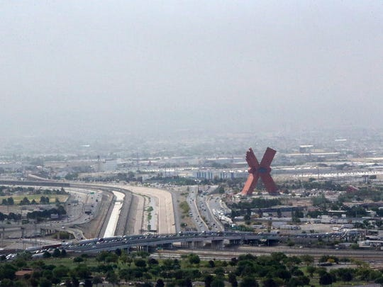 "Heavy smoke is visible over the giant red ""X"" sculpture along the Mexican side of the U.S.-Mexico border and the Bridge of the Americas international port of entry at bottom May 2. The smoke was from a fire at a recycling plant on the outskirts of Juárez."