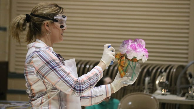 Nichole Wiechman, chemistry teacher at PCHS, performs a science experiment demonstration at the ICS Science Night.