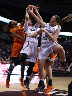 The Missouri State Lady Bears's Lexi Hughes and Hillary Chvatal fight for the rebound against Oklahoma State University at JQH Arena in Springfield on November 23, 2015.