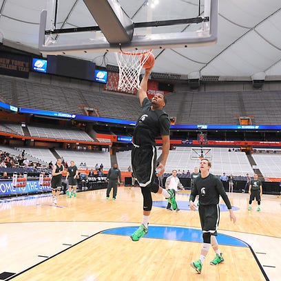 MSU's Marvin Clark Jr. dunks during the Spartans' NCAA practice Thursday in Syracuse, N.Y. The Spartans and Sooners tipoff Friday after 10 p.m. at the Carrier Dome.