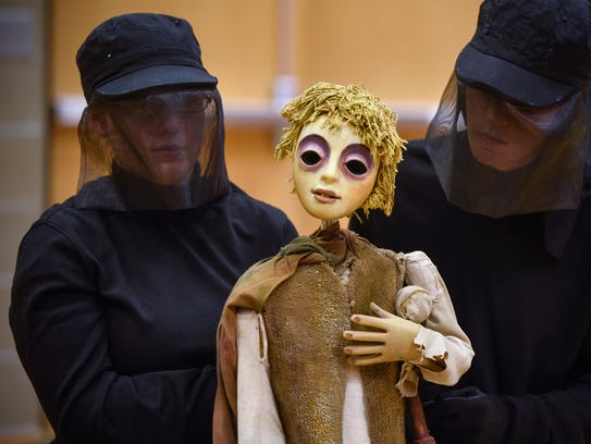Students concentrate while controlling the puppet of