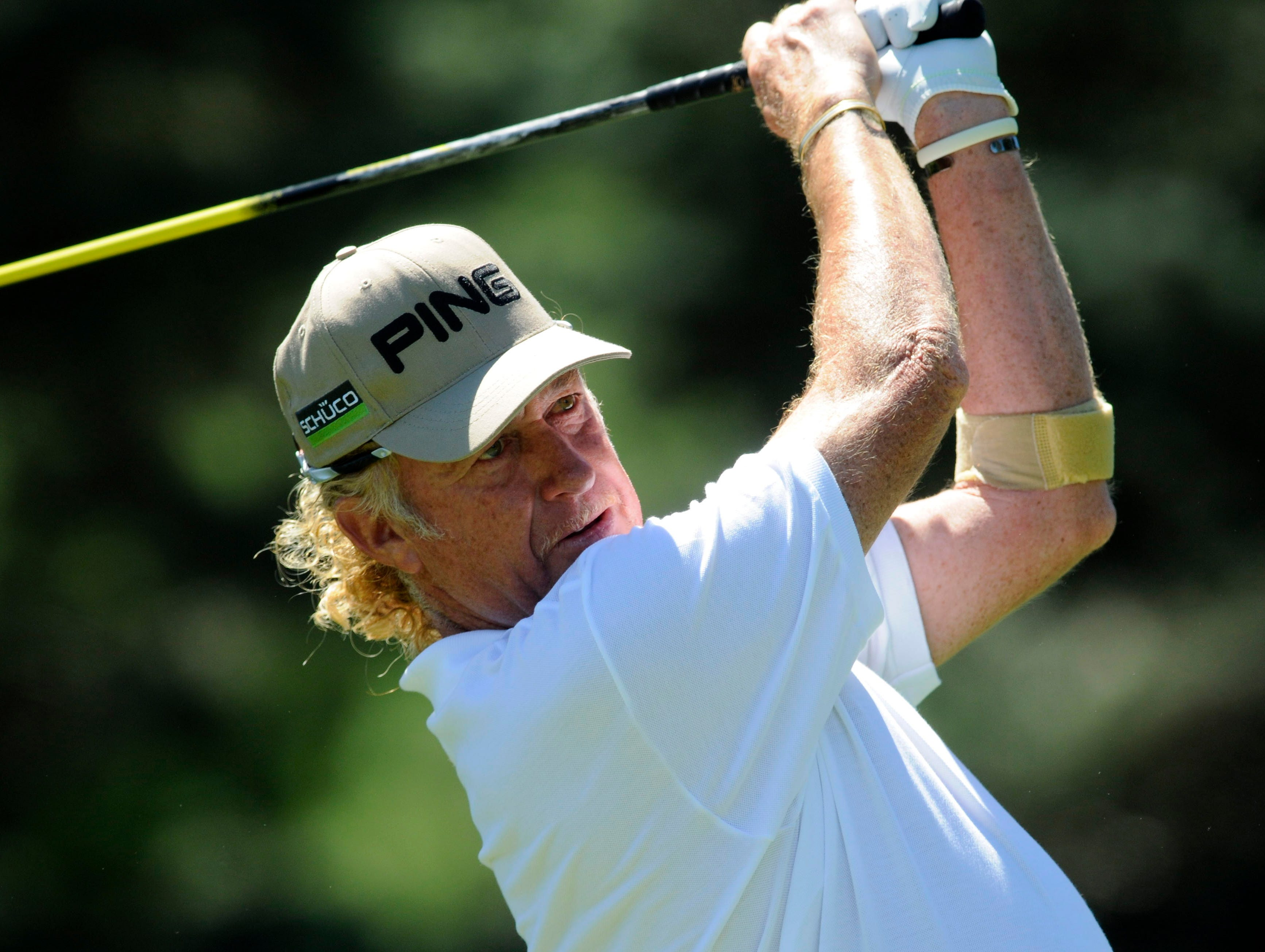 Miguel A. Jimenez tees off on the seventh hole.
