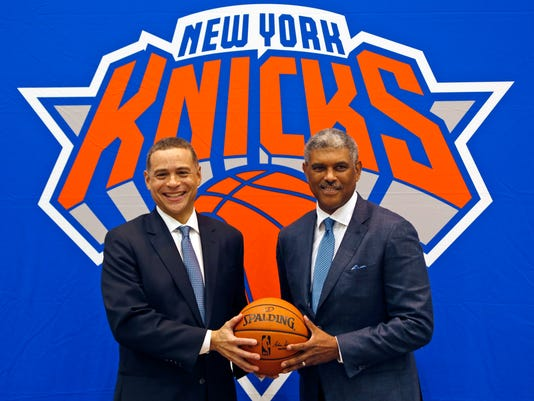 FILE - This July 17, 2017 file photo shows New York Knicks general manager Scott Perry, left, and president Steve Mills posing for a picture after a news conference in Greenburgh, N.Y. Mills and Perry are trying to change the identity of the New York Knicks. The Knicks had become a franchise good at producing chaos but not much else. Mills says they knew there were a lot of things that needed to change, and they're in the process of doing that. Mills and Perry want the Knicks to known as a team that competes hard, works hard, defends hard. Magic Johnson has noticed the change. So has Carmelo Anthony. (AP Photo/Seth Wenig, file)