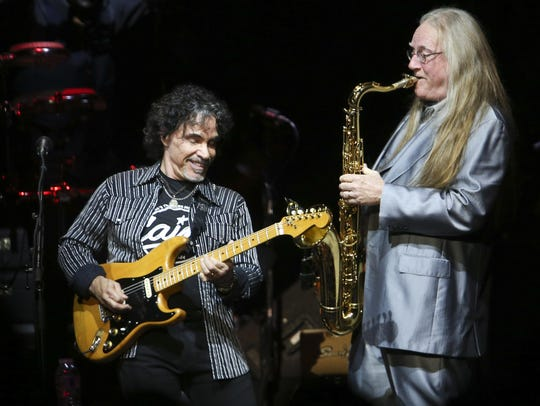 John Oates, left, performs with Charles DeChant during