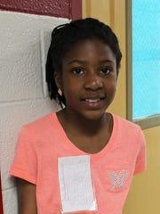 Mt. Horeb third grader Selita Ikejibeh displays her pocket poem on April 21, National Poem in Your Pocket Day.
