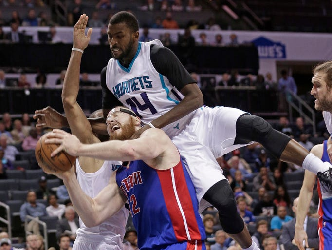 Detroit Pistons' Aron Baynes (12) is fouled by Charlotte