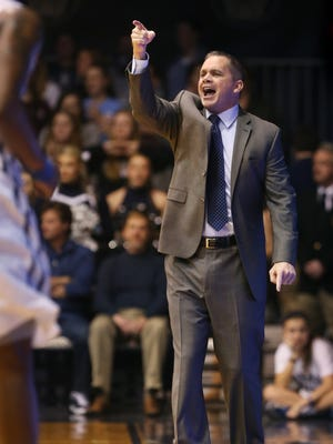 Butler coach Chris Holtmann gives his team instructions during the first half of a 73-52 win over Marquette at Hinkle Fieldhouse on Feb. 25, 2015.