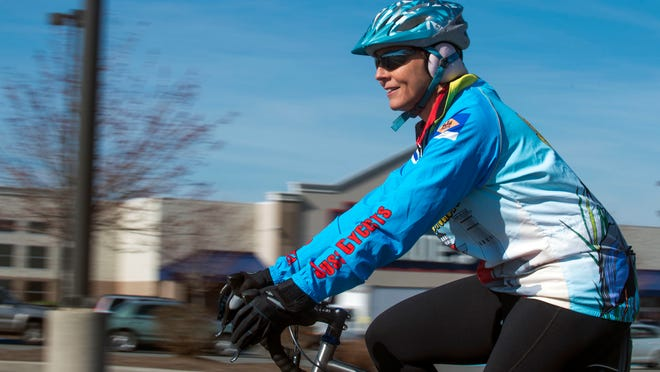 Michele Williams, of Lewes, cruises around on her bike before riding out of Millsboro.