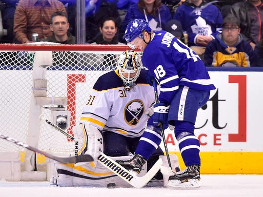Toronto Maple Leafs left winger Andreas Johnsson (18) shoots on Buffalo Sabres goaltender Chad Johnson (31) during first period NHL hockey action in Toronto on Monday, April 2, 2018. (Frank Gunn/The Canadian Press via AP)