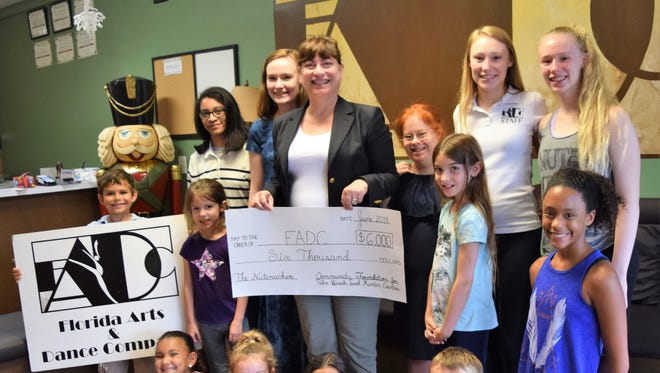 """Florida Arts & Dance Co. President Joann Gallagher, surrounded by dance students and supporters, recently received a $6,000 grant from the Community Foundation for Palm Beach and Martin Counties to support its December production of """"The Nutcracker."""""""