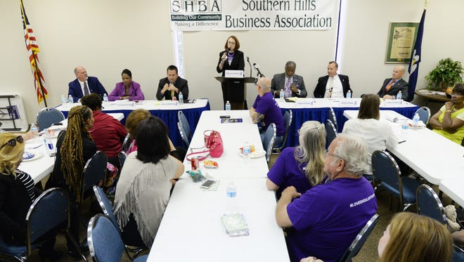 Moderater Molly Corbett stands in the middle with DA Candidates (left to right) Lee Harville, LaLeshia Walker Alford, Dhu Thompson, James Stewart, Mark Rogers and J. Casey Simpson during the Domestic Violence Political Forum Thursday afternoon at the Southern Hills Business Association.