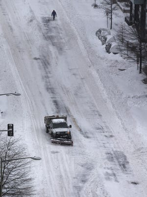 A blizzard with hurricane-force winds brought much of the East Coast to a standstill, dumping as much as 3 feet of snow, stranding tens of thousands of travelers and shutting down the nation's capital.