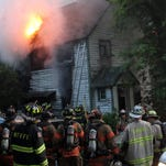 Mahopac Falls firefighters, with help from several neighboring departments, battle a fire that destroyed a home at 7 Barrett Place in Mahopac Falls May 31, 2016.