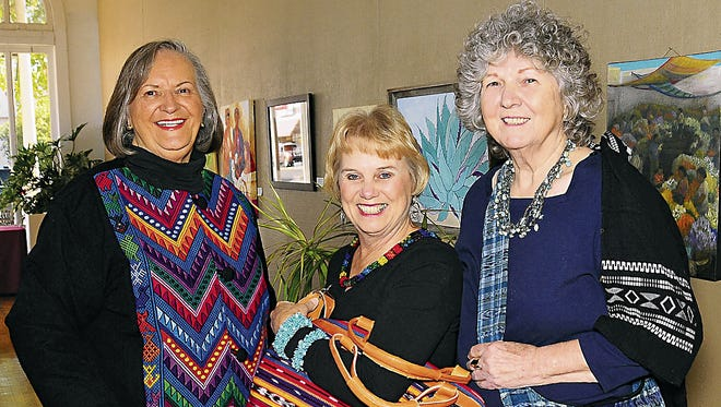From left are Jane Fricano, Diane Hudgens and Bette Waters examining some of the wares that will be on sale at the Guatemalan Mercado hosted annually at the Deming Arts Center by the Deming Arts Council, 100 S. S. Gold St. The sale begins at  noon on Friday and again at 9 a.m. on Saturday.