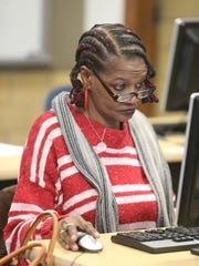 Jacklyn Perkins works on her English skills during GED classes at the West Campus-Adult Education Center in Detroit.
