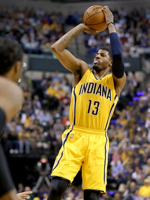 Indiana Pacers forward Paul George (13) hits a three-pointer in the second half of their game Sunday, April 5, 2015, evening at Bankers Life Fieldhouse. The Pacers defeated the Heat 112-89.